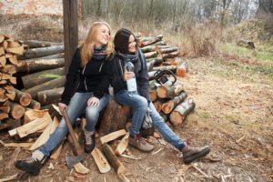 two girls preparing firewood